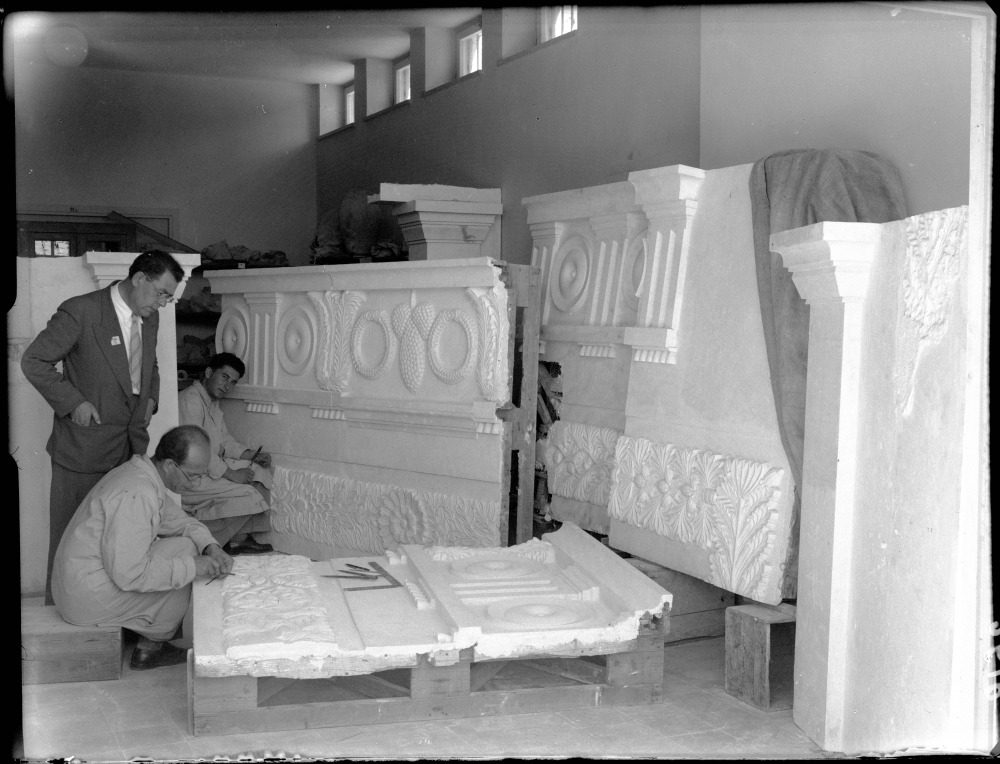 Preparation of a replica of the frieze from the Tomb of the Kings façade, in the Collections Hall of the Museum building, left: Prof. E. L. Sukenik (standing) (1940's), (The Hebrew University Photo Archives).