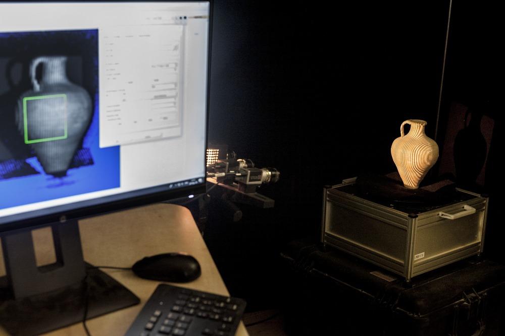 Scanning ceramics at the 3D lab; photo by Tal Rogovski